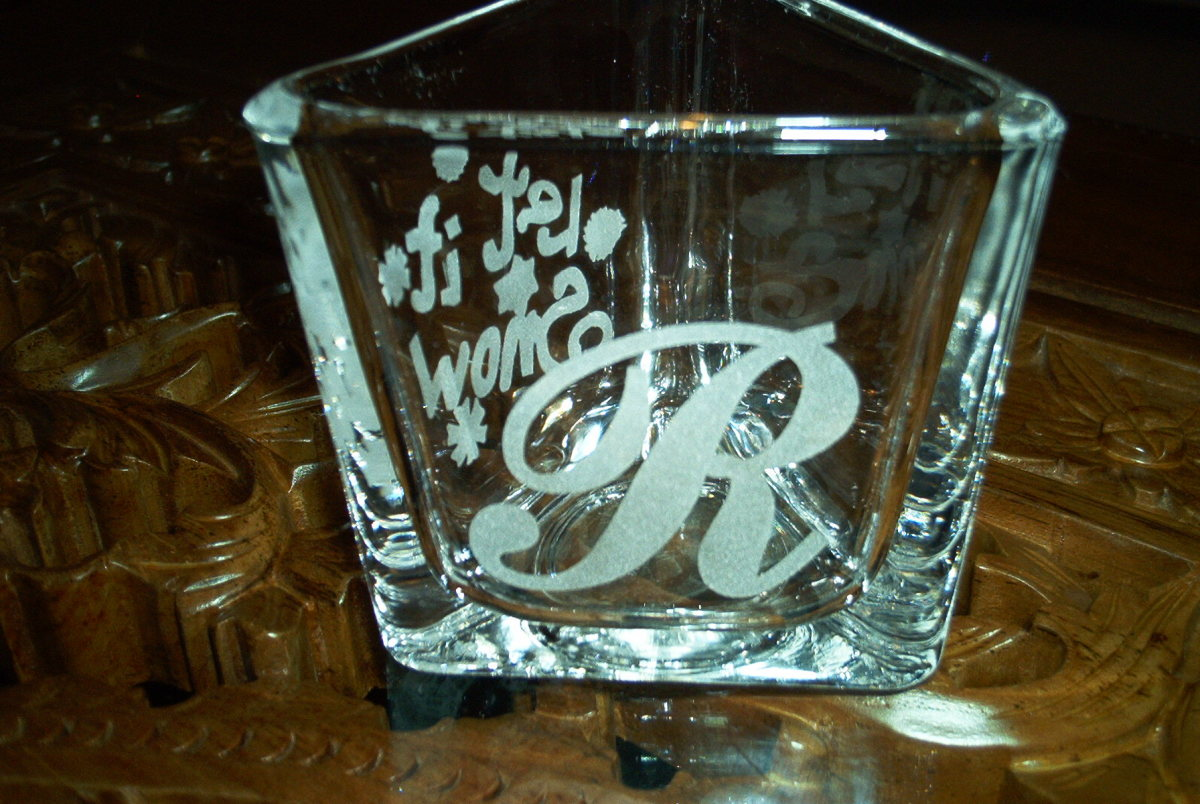 Sandblasted cup. Cut the vinyl and used as masking for sandblasting or glass etching
