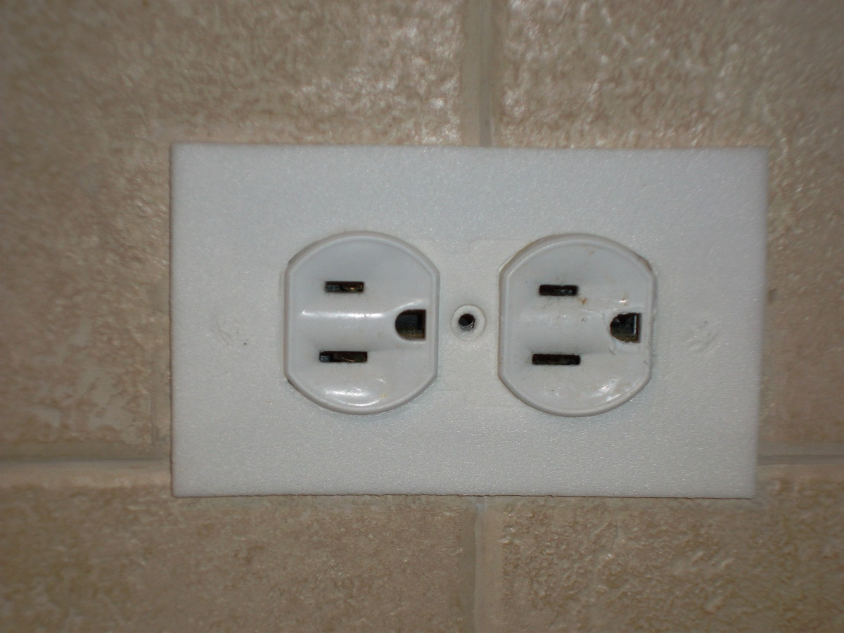 Lay pre-cut piece of foam insulation in outlet and replace cover plate.