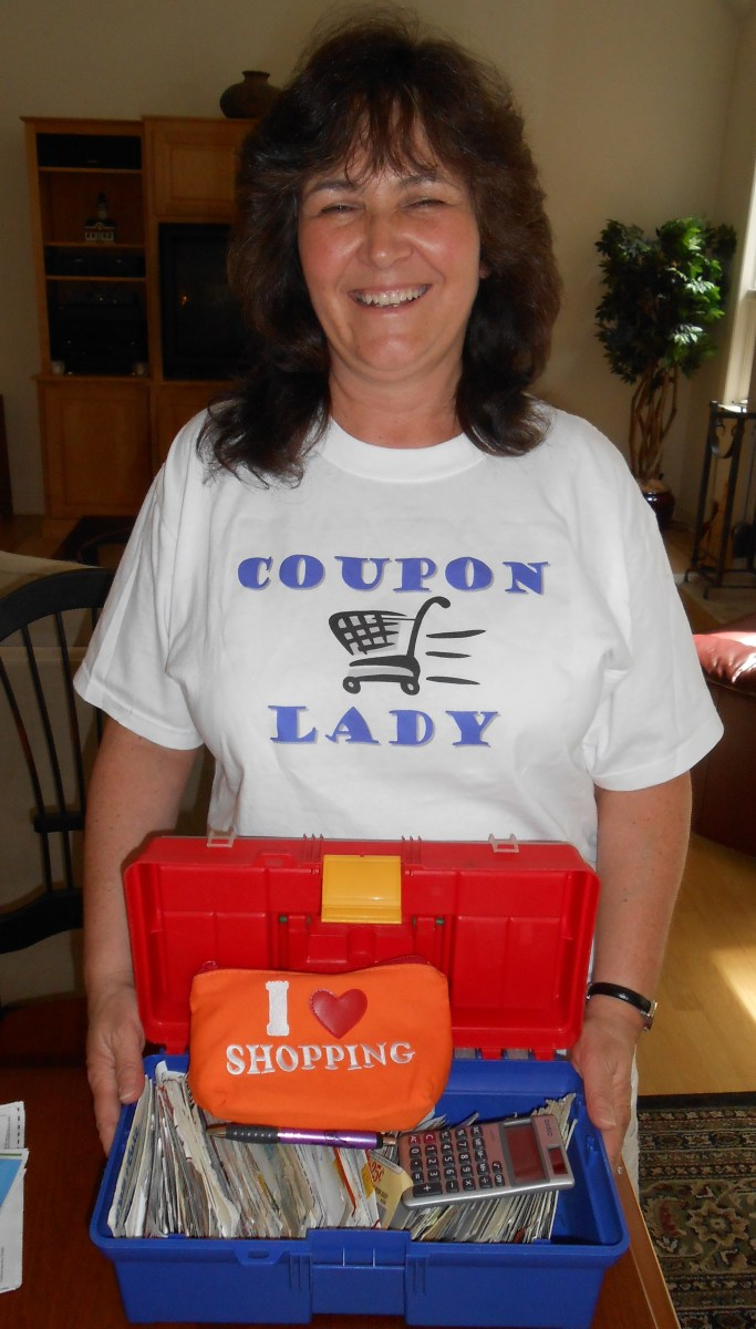 Here I am with the tools of the trade. I always bring my main coupon holder, and the smaller one, which holds an envelope of coupons for each store I shop at to each class so they can see how it pays to be organized.