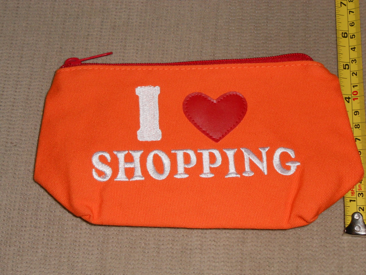 This cute zippered pouch is one I keep my coupons that I will use in a certain shopping trip rather than an envelope because it's sturdier, and it makes me happy! I have a large craft box container that I bring with too.