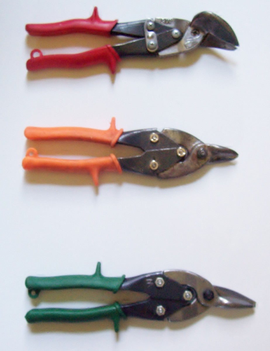 "Tin snips.  At top:  a ""left"" or ""red""; middle, a ""straight""; at bottom, a ""right"" or ""green"""
