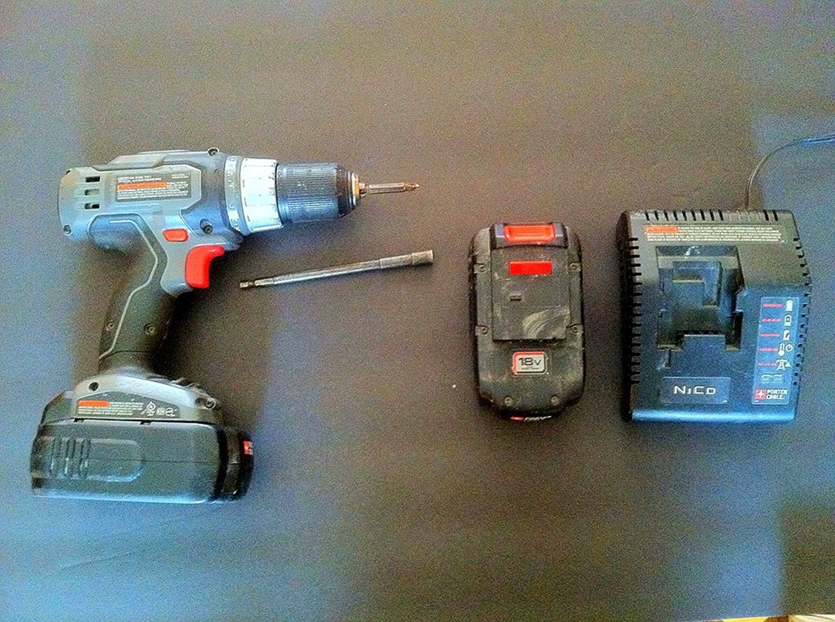 18-volt battery operated drill with two batteries, a charger, and commonly used bits.