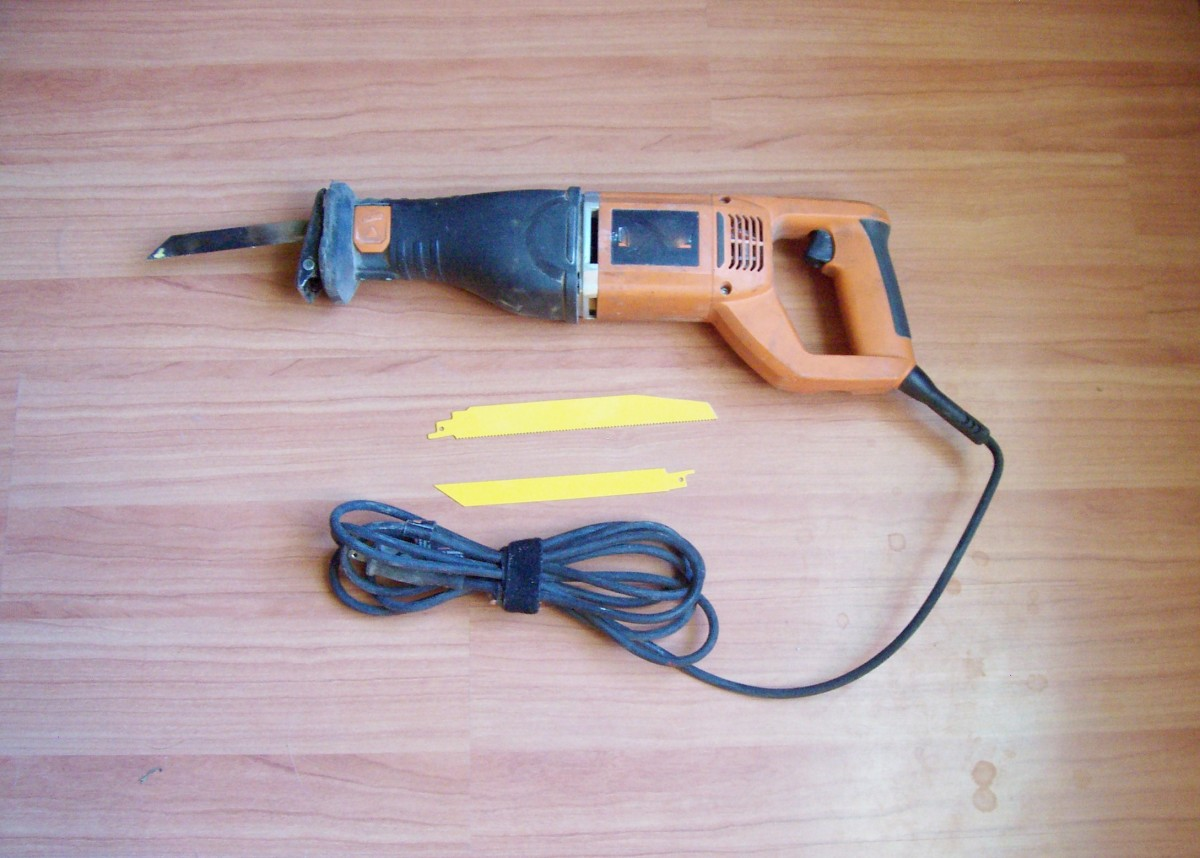Electrically powered sawzall with wood and metal blades. (A battery operated type can come in handy sometimes.)