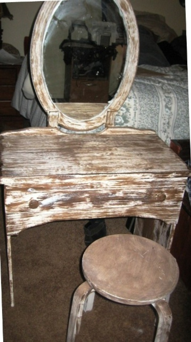 Recycled  desk, with recycled bathroom vanity mirror.  Add a stool and you have a new antique vanity set.