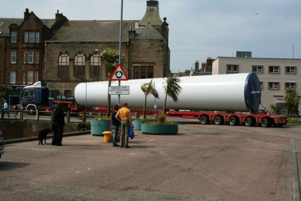 A long vehicle maneuvering city streets in Campbeltown, Scotland.