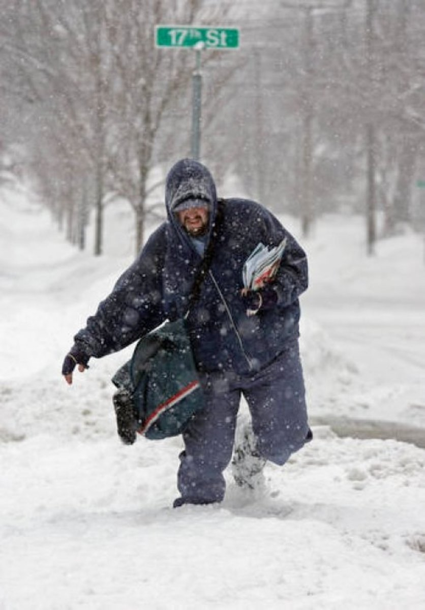 So you think you're ready to brave the elements?  Good luck trying to talk your boss out of it.  Here Mailman Bill Margo trudges though deep snow in Cuyahoga Falls, Ohio.