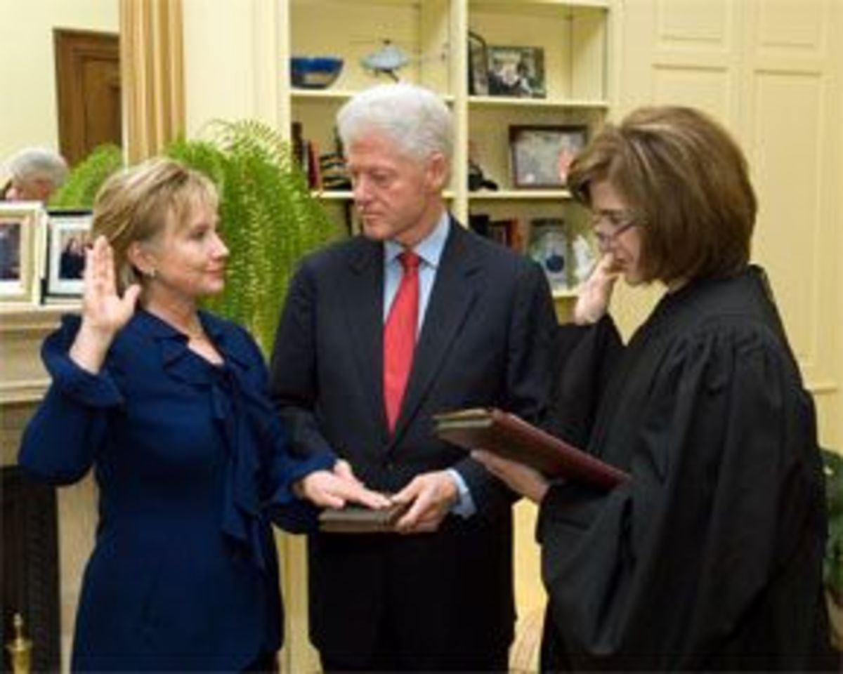 Secretary of State Hillary Clinton, with her husband, being sworn into office, in 2009.