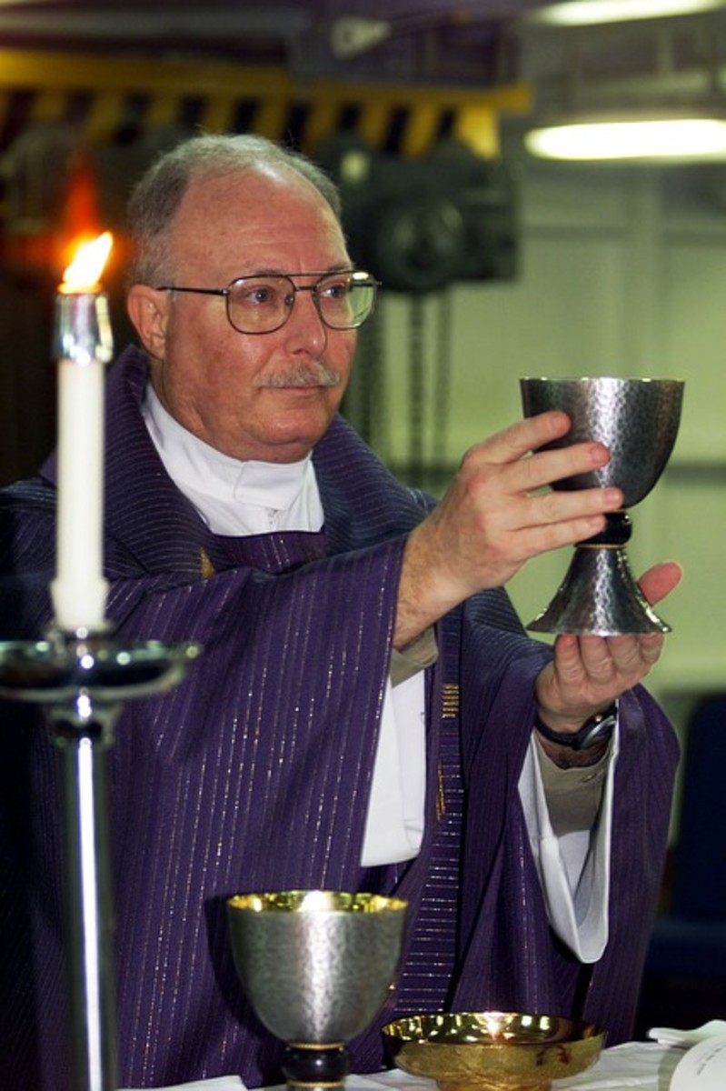 A priest at the altar prepares to serve communion to his congregants who are in need of healing and spiritual guidance.