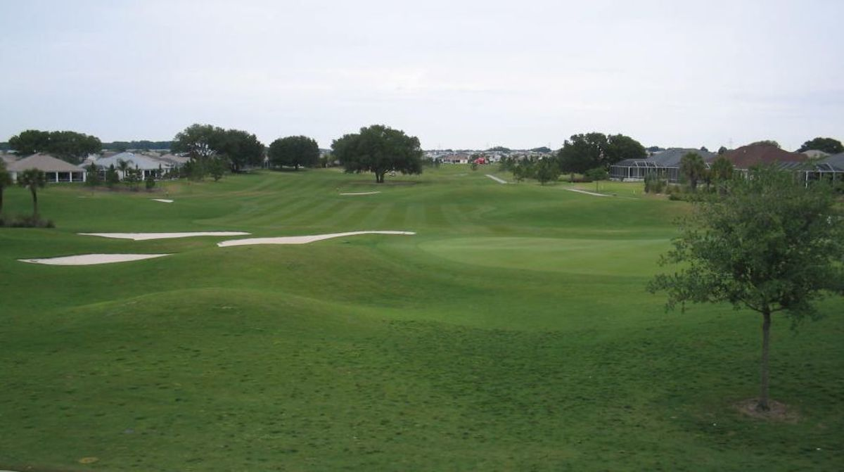 The Villages has multiple leisure and sports facilities, including nine country club golf courses.  Pictured is the 18th green at Tierra Del Sol.  Shopping, restaurants, and other facilities are all generally withing range of a short golf cart ride.