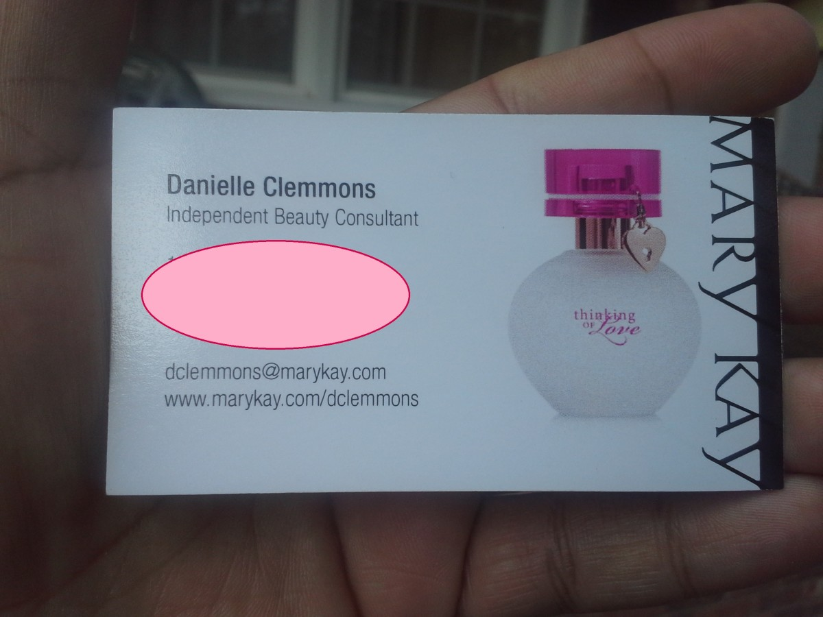 Professional business card on high-quality, semi-gloss paper. (The pink circle is covering up personal info, not a part of the card.)