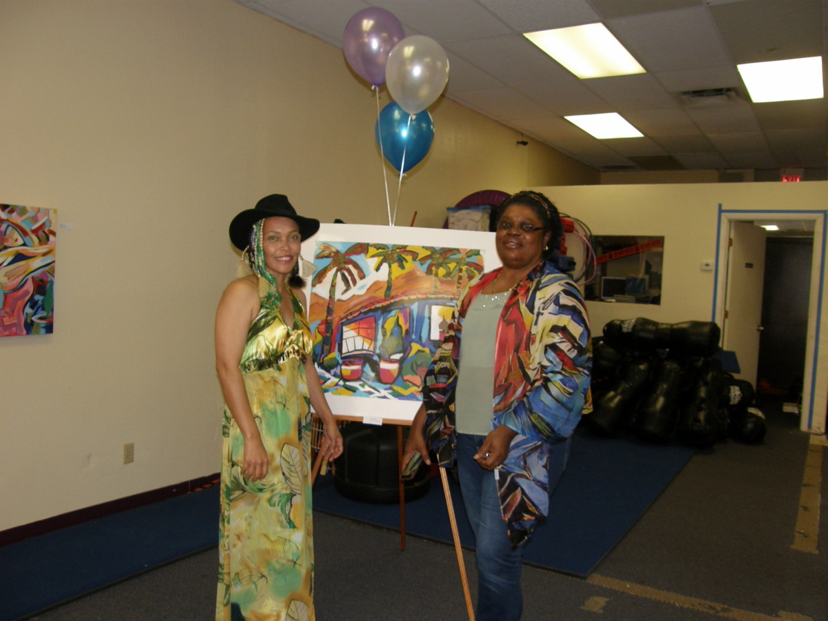 The Author and her friend, Moyaha, who is modeling one of the Author's wearable art pieces, a scarf.