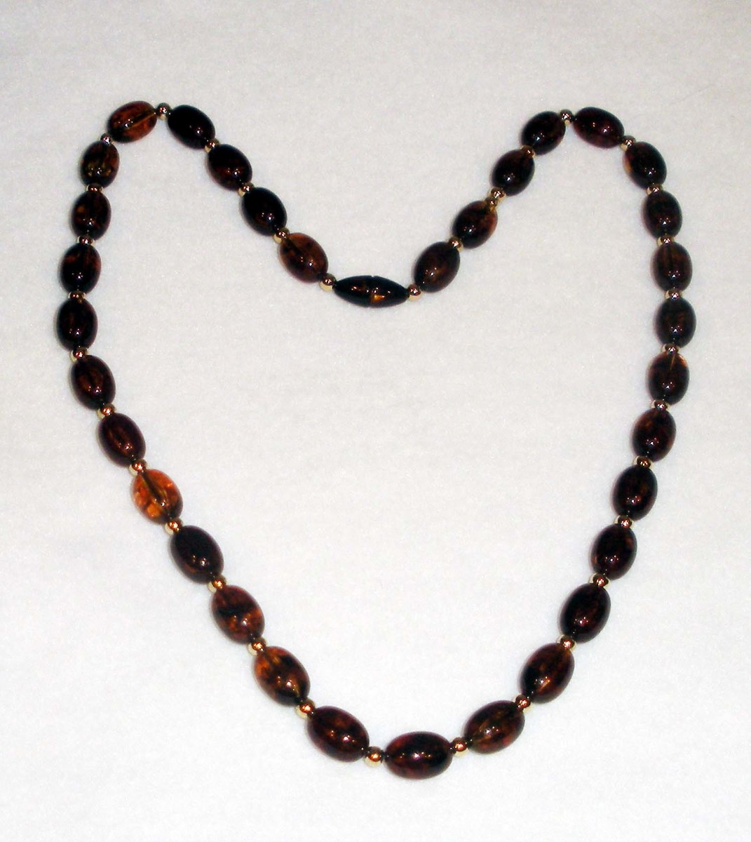 Ah--there it is!  Nice and tightly cropped, on a clean, bright background that offers maximum contrast, and well lit, showing the variations in the beads