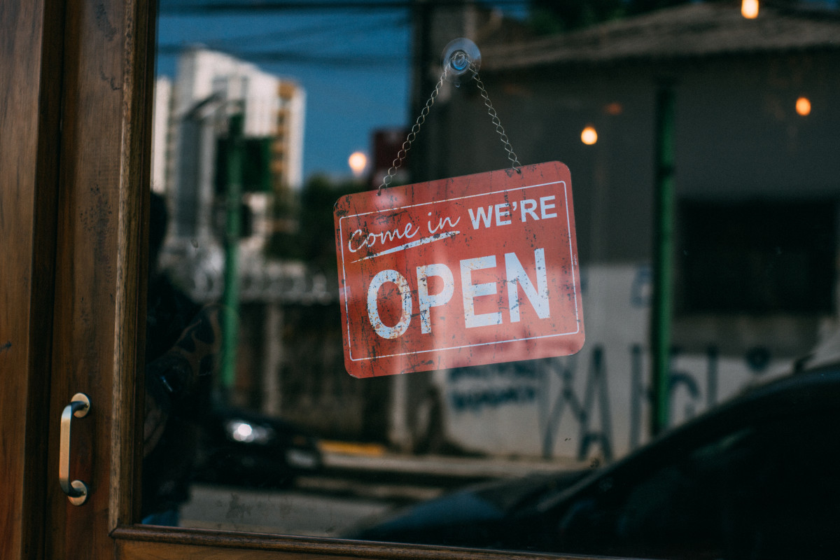 An open sign on a storefront.
