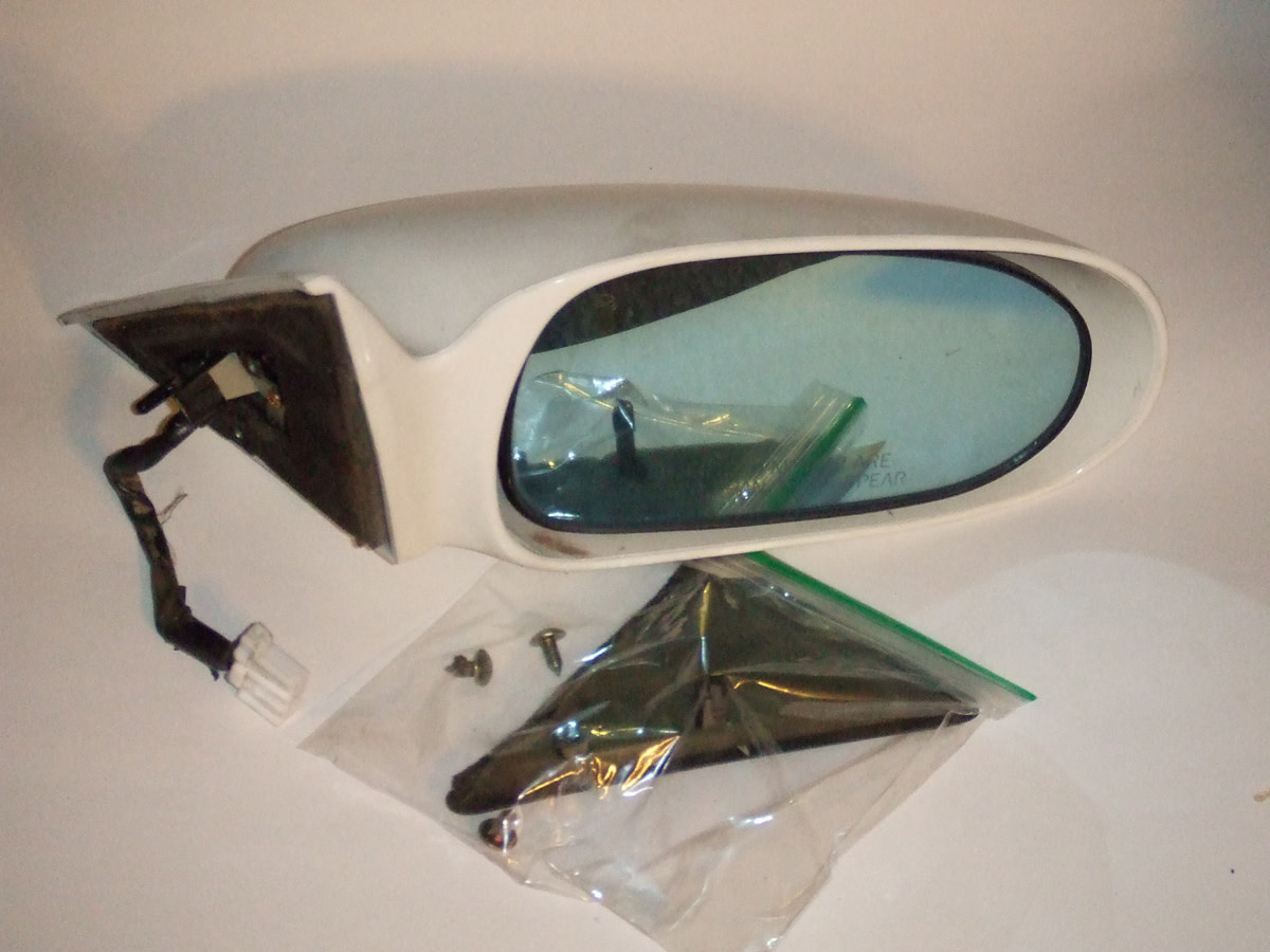 Side mirror from my old 1993 Mazda.  I didn't have much trouble selling most of the parts from this car online.