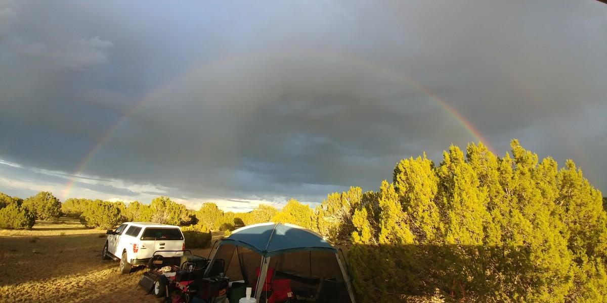 A rainbow forms after an afternoon monsoon season rain