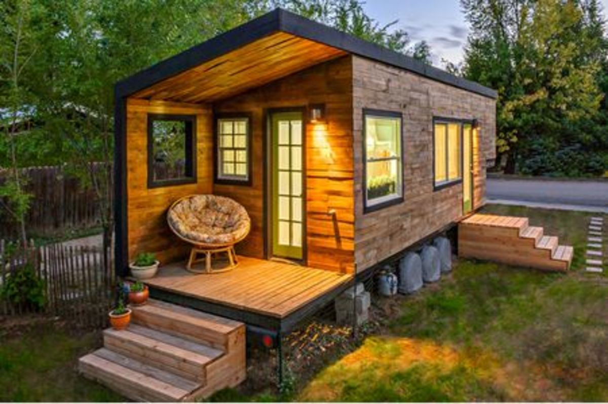 This tiny house, built by Macy Miller, cost less than $12000. She bought an old RV for $500 and used recycled materials, money saving features such as a composting toilet, and radiant floor heating to save money on building.
