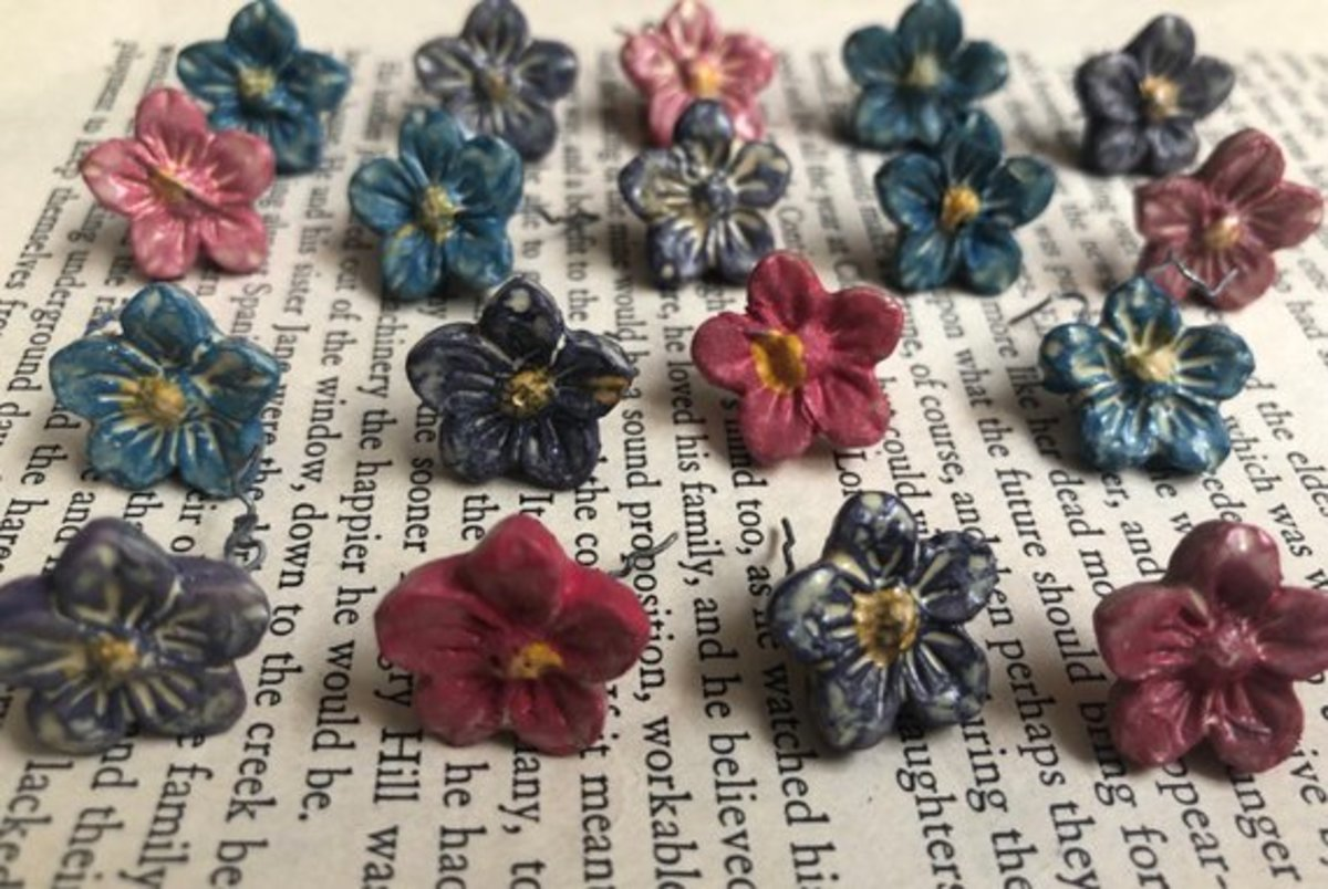 These little flowers pop on the background of an old book. The only problem may be a slight shadow, which is not really a problem in this case.