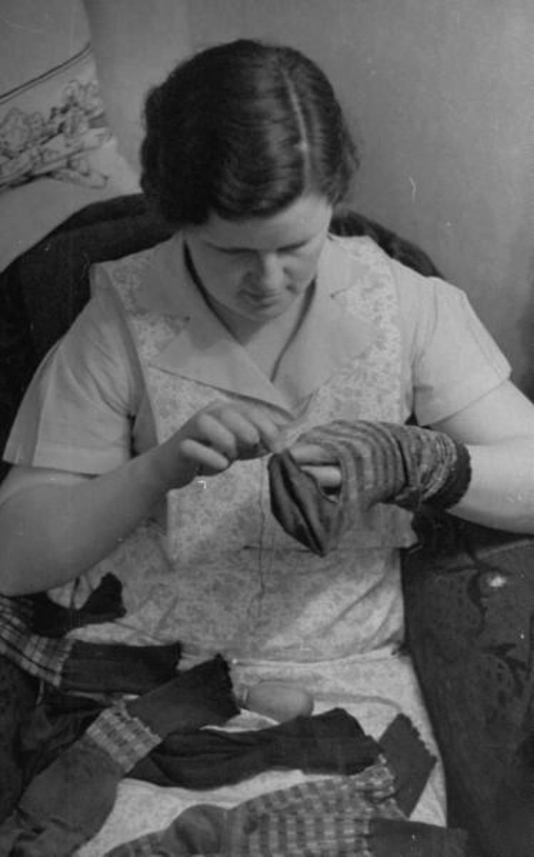 A Woman Darning a Sock
