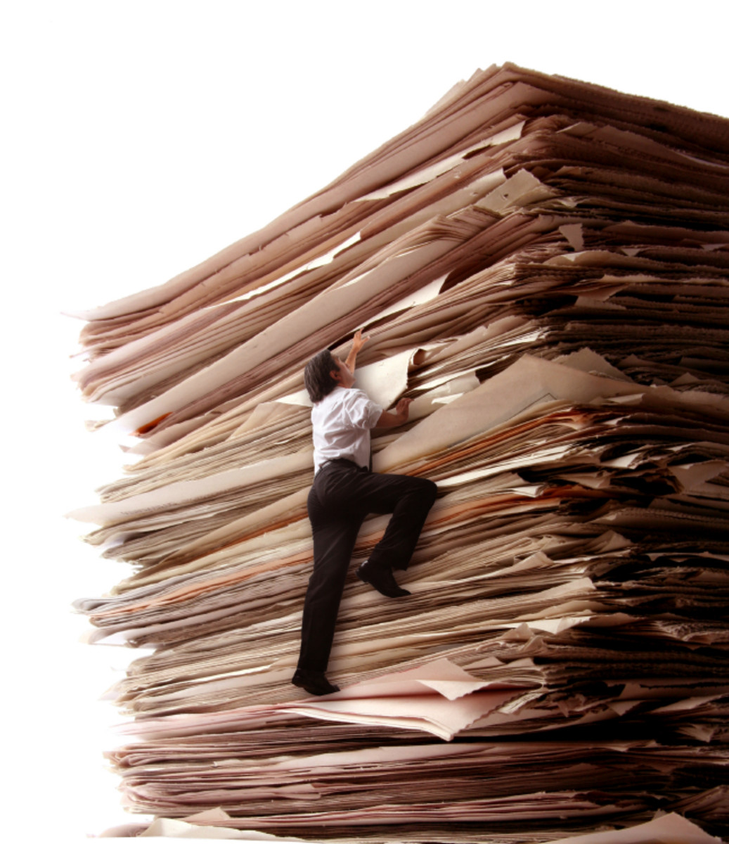 Did your bully boss suddenly fill your file with mountains of paper.