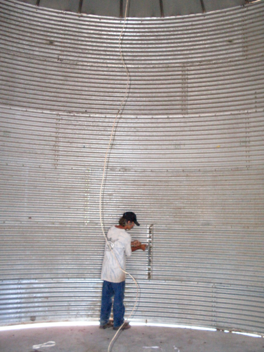 Hubby hard at work on stiffeners, which are bars that help the bin hold up against the thousands of pounds of grain without buckling.