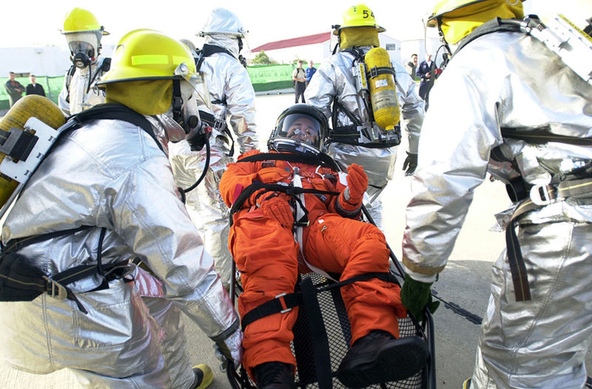 Space Shuttle Medical Support Team transport Hospital Corpsman 3rd Class Johnny Stewart to treatment area.
