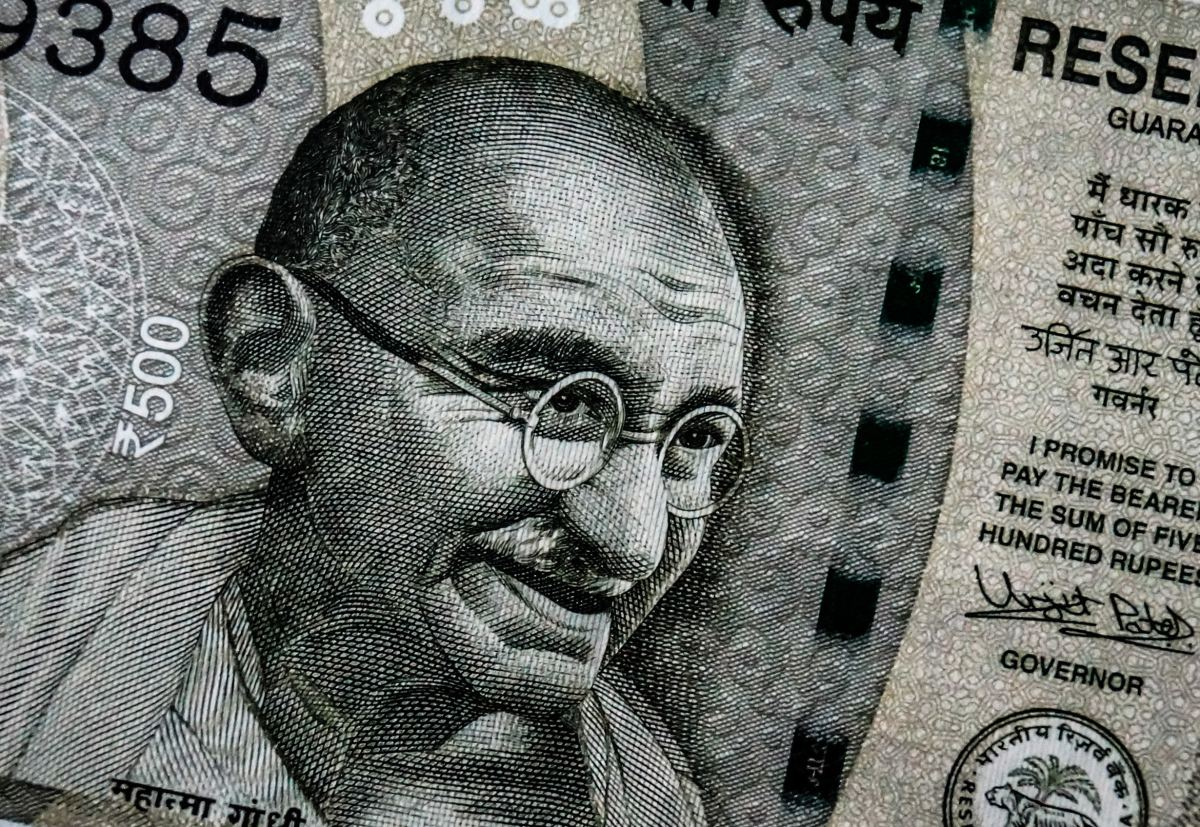 Portrait of Mahatma Gandhi on a rupee.