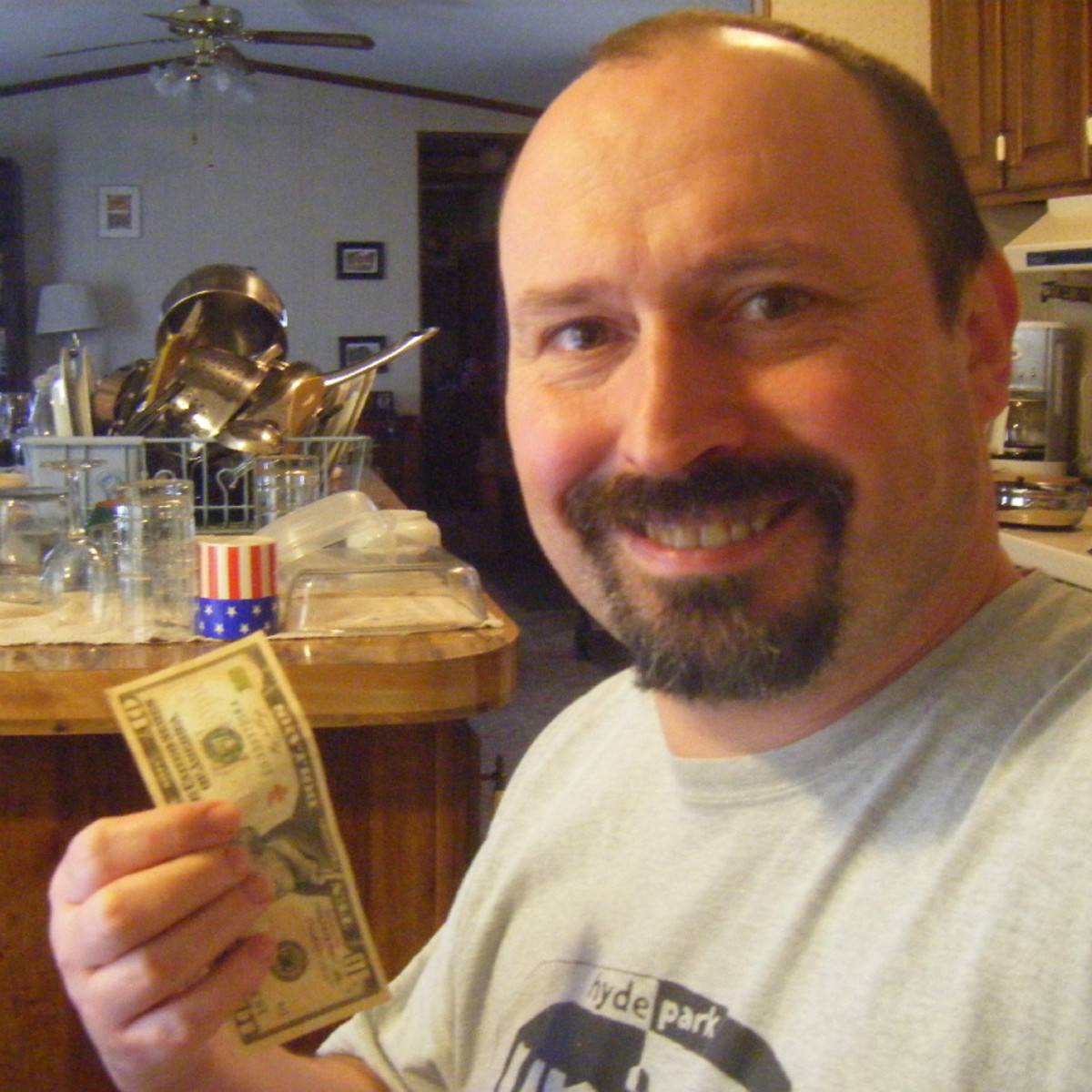 The author with a dollar bill.  It is easy to earn with Mechanical Turk, but it is difficult to earn a living wage.  Over time, the payment levels have gradually shrunk.