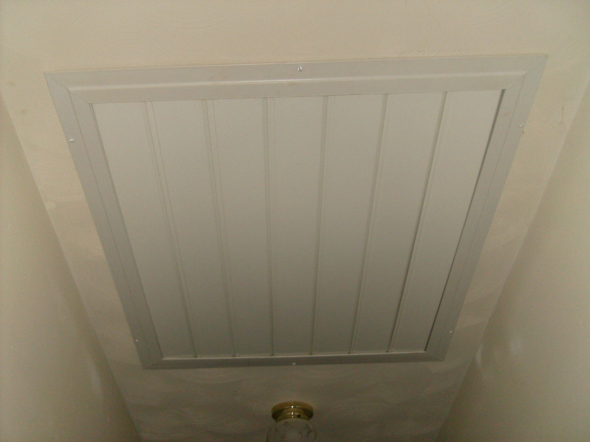 This is the attic fan that my stepdad installed in my hallway. The fan is installed up above the open slats (in the attic) which open when the fan is switched on. (Remember to open the windows before switching on!)