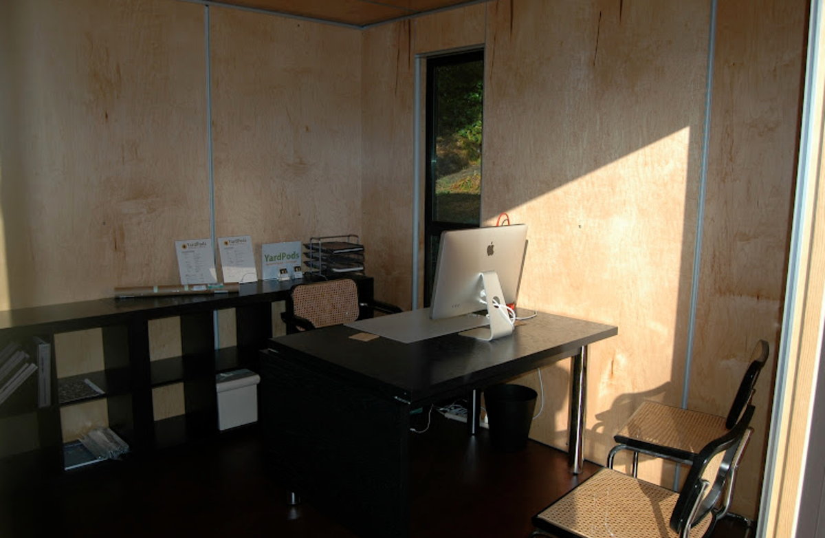 A simple, unadorned interior of a YardPod - great for small outdoor offices like this one.