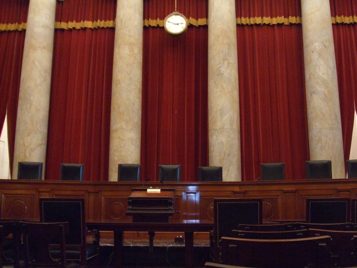 "A picture of the inside of the Supreme Court where oral arguments are presented to the justices. Attorneys presenting their argument before the Court have remarked that their proximity to the nine justices is ""intimate."""