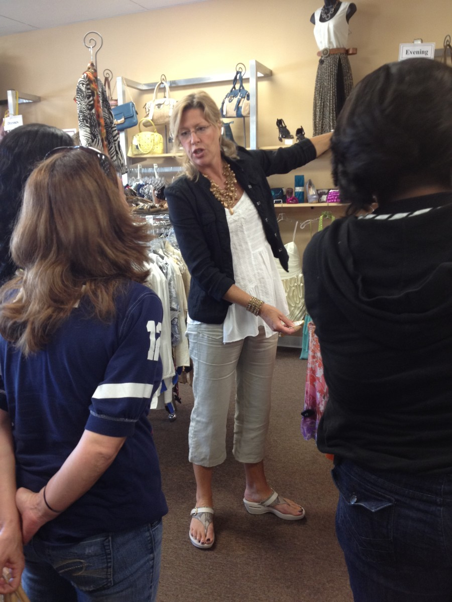 Kristina gives the students a tour of the store while discussing style and price.