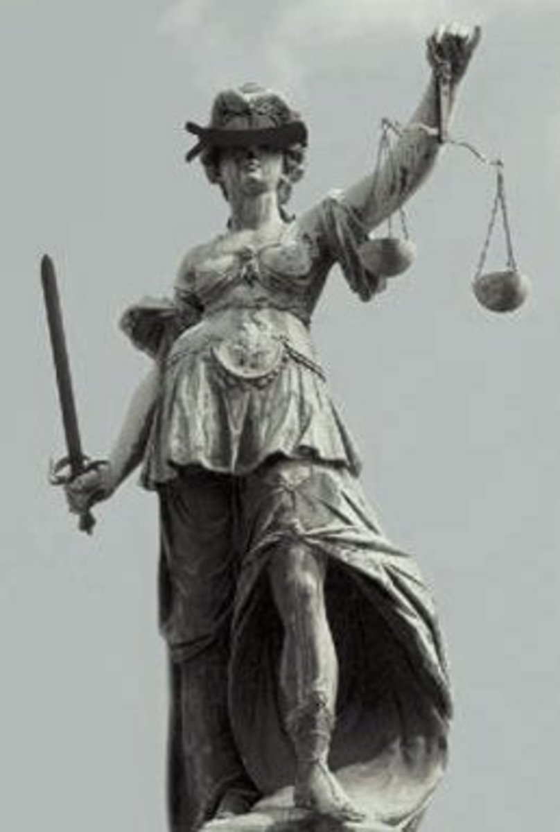 The blindfold on lady justice is a sign of her blindness to personal agendas, status, bribery, and other elements that bias us away from the truth.