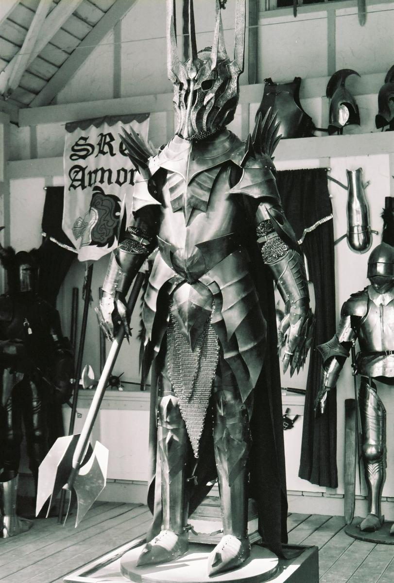 Replica armor of the Dark Lord of the Rings Sauron. The costume is the result of the positive synergy of a great team The figure shows the ultimate negative synergy - people and monsters working together for destruction, and undercutting one another.