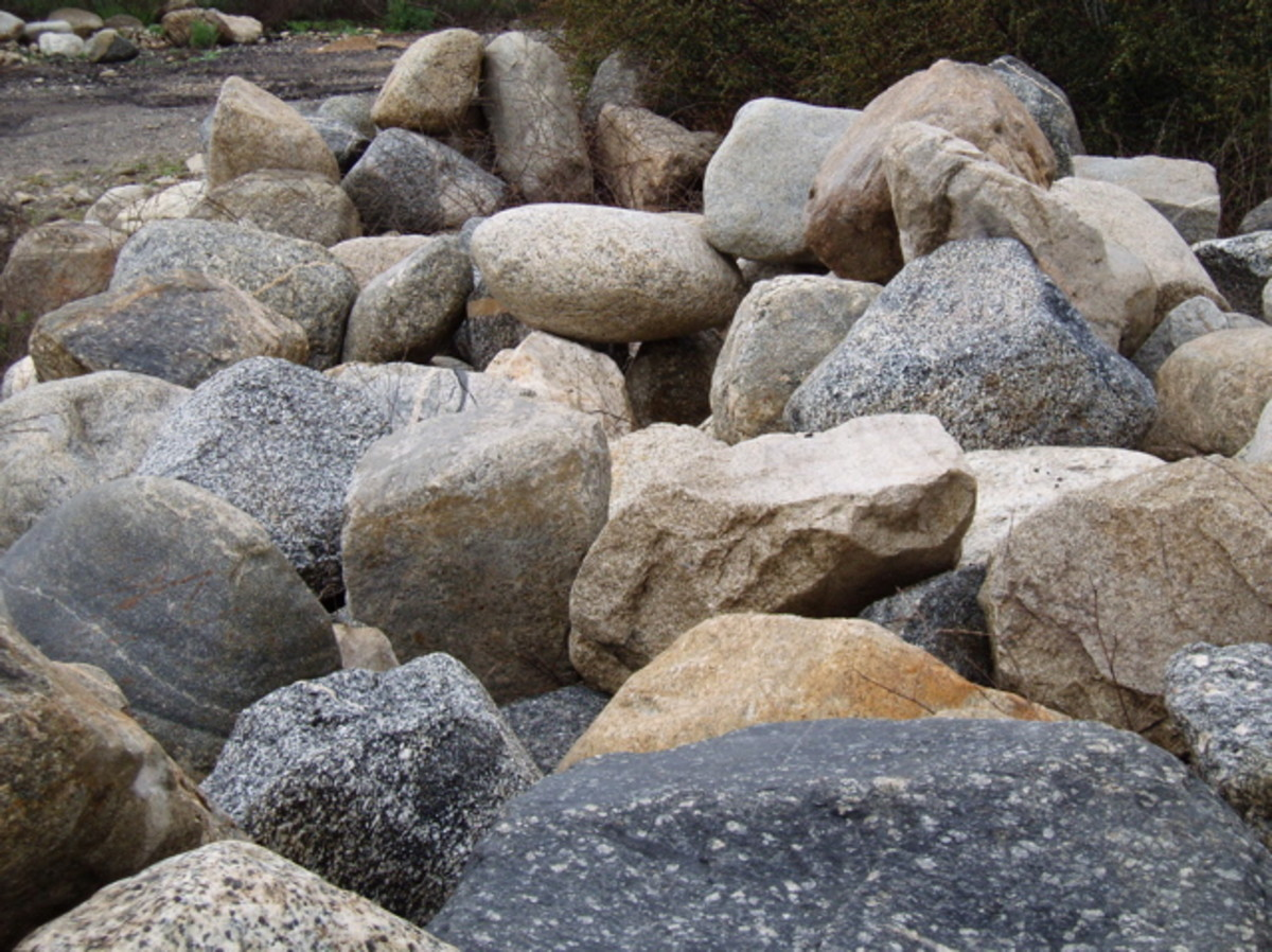 These are small rocks carried down from the mountains in Southern California. Some storms have carried down boulders weighing tons.