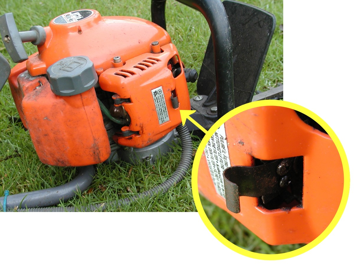 Spring clips can be made from clocksprings. I replaced the broken plastic clip on the cover of this hedge trimmer with a piece of clock spring