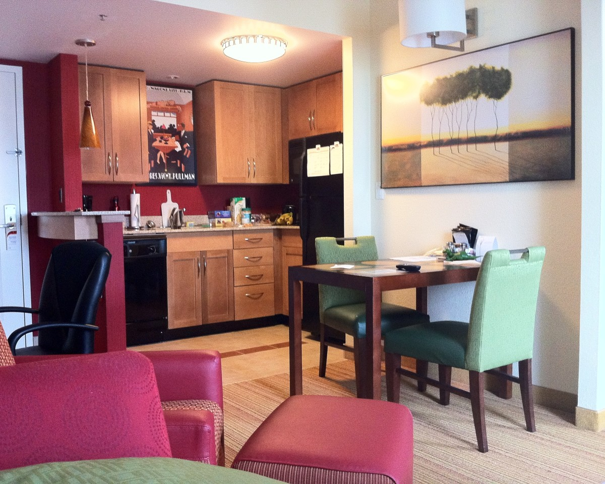 A hotel room with a kitchen in it can save you a lot of money on food on your vacation.