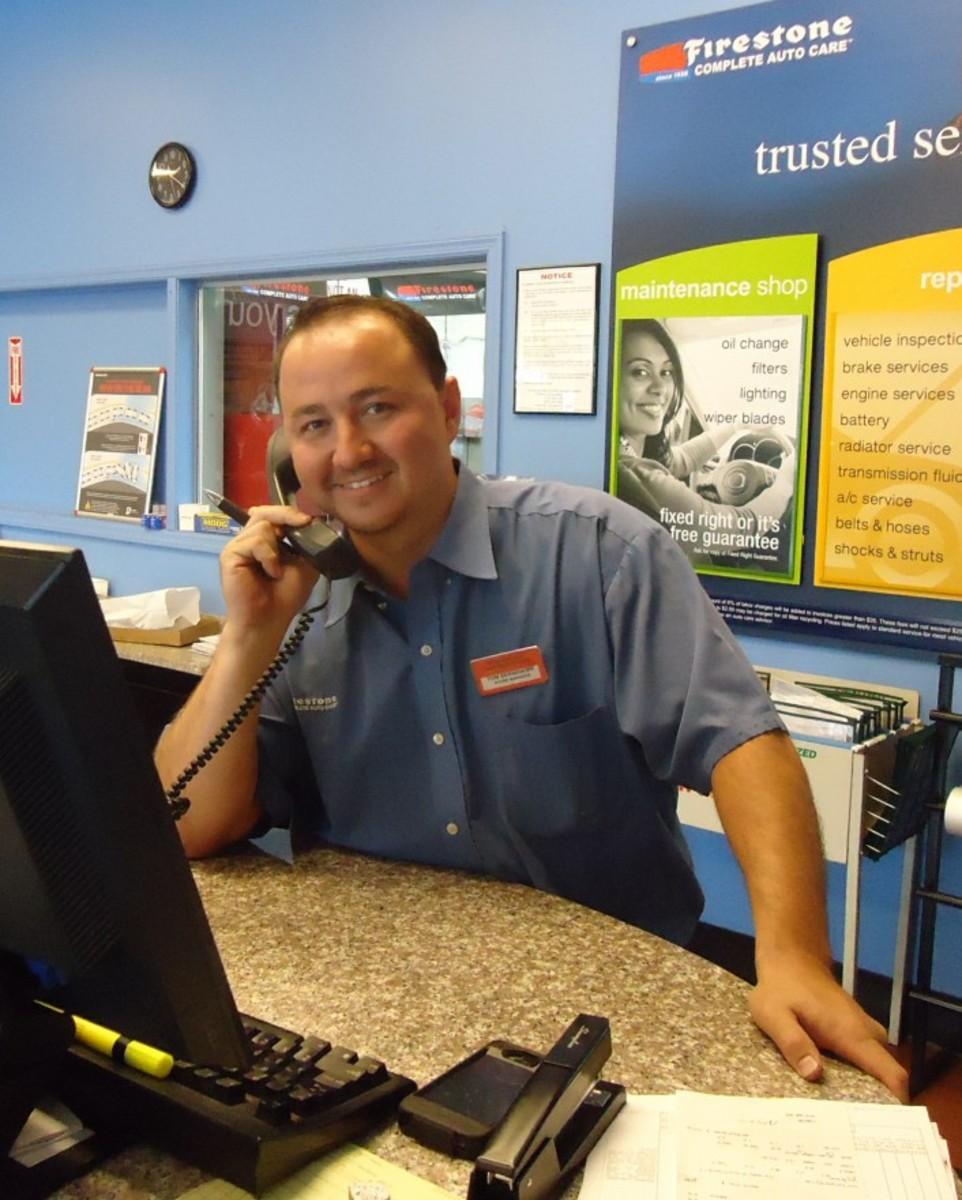 A Firestone customer service representative in Berkeley Heights, New Jersey. June, 2012.