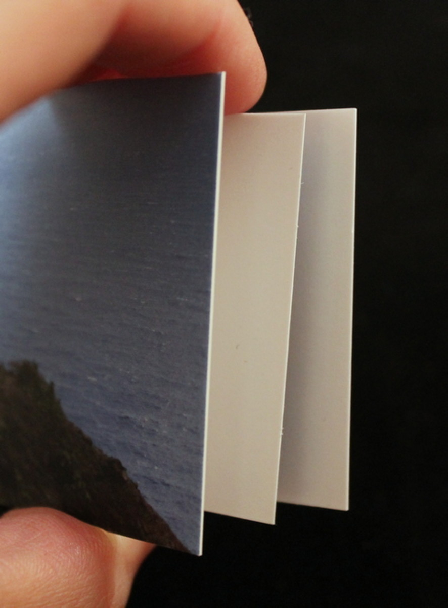 The Moo card is noticeably thicker.