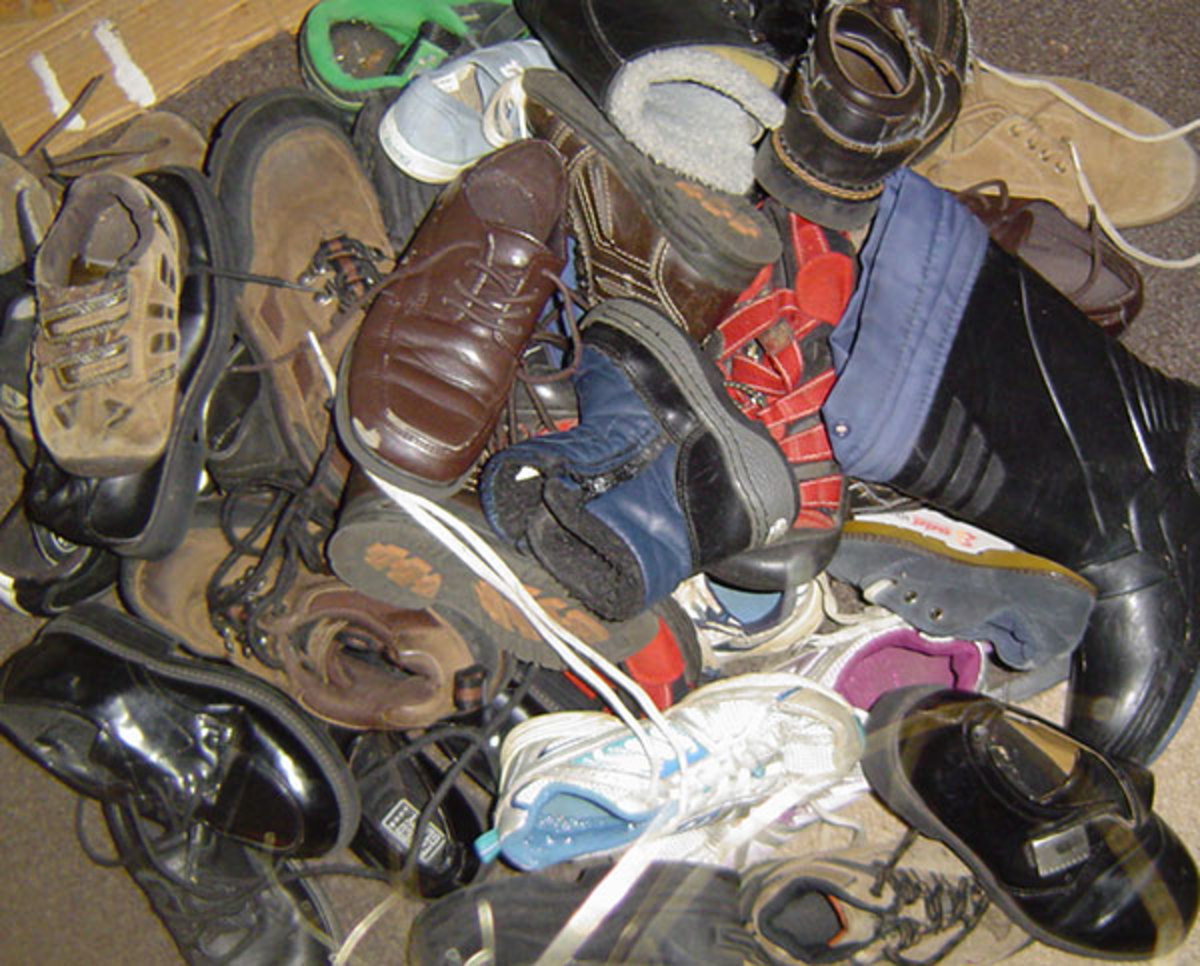 "All these shoes and boots (and probably as many more, scattered elsewhere) were given to us.  Most were hand-me-downs.  If any don't look ""beat up"", it's probably the ones we forgot to use while they fit!"