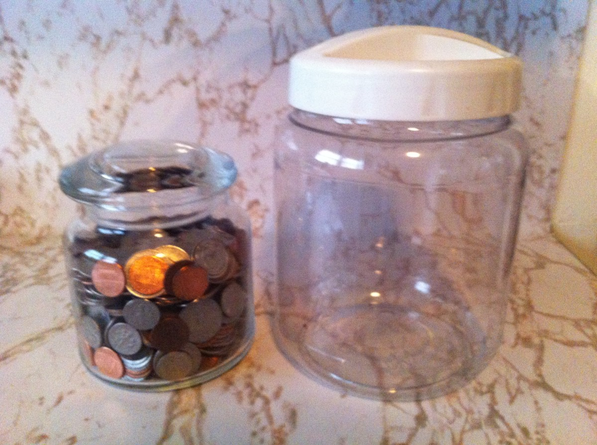 A coin jar next to a much larger container.