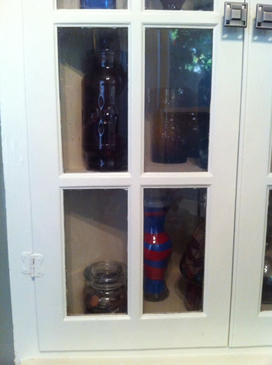 The coin jar is nicely tucked away inside of a cabinet.  Don't leave it exposed for someone to spend or steal it.
