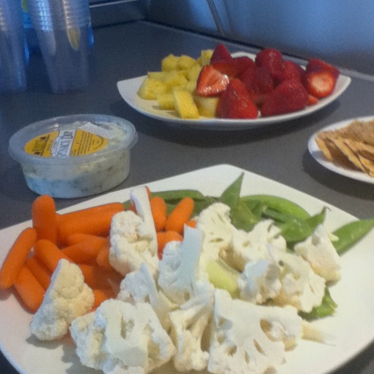 Fresh fruit and veggies are always popular at potluck lunches.