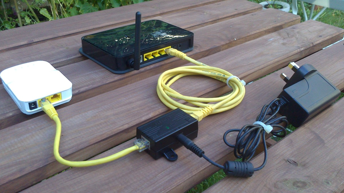 This picture shows an Open-Mesh router being powered using a Power over Ethernet injector (PoE).