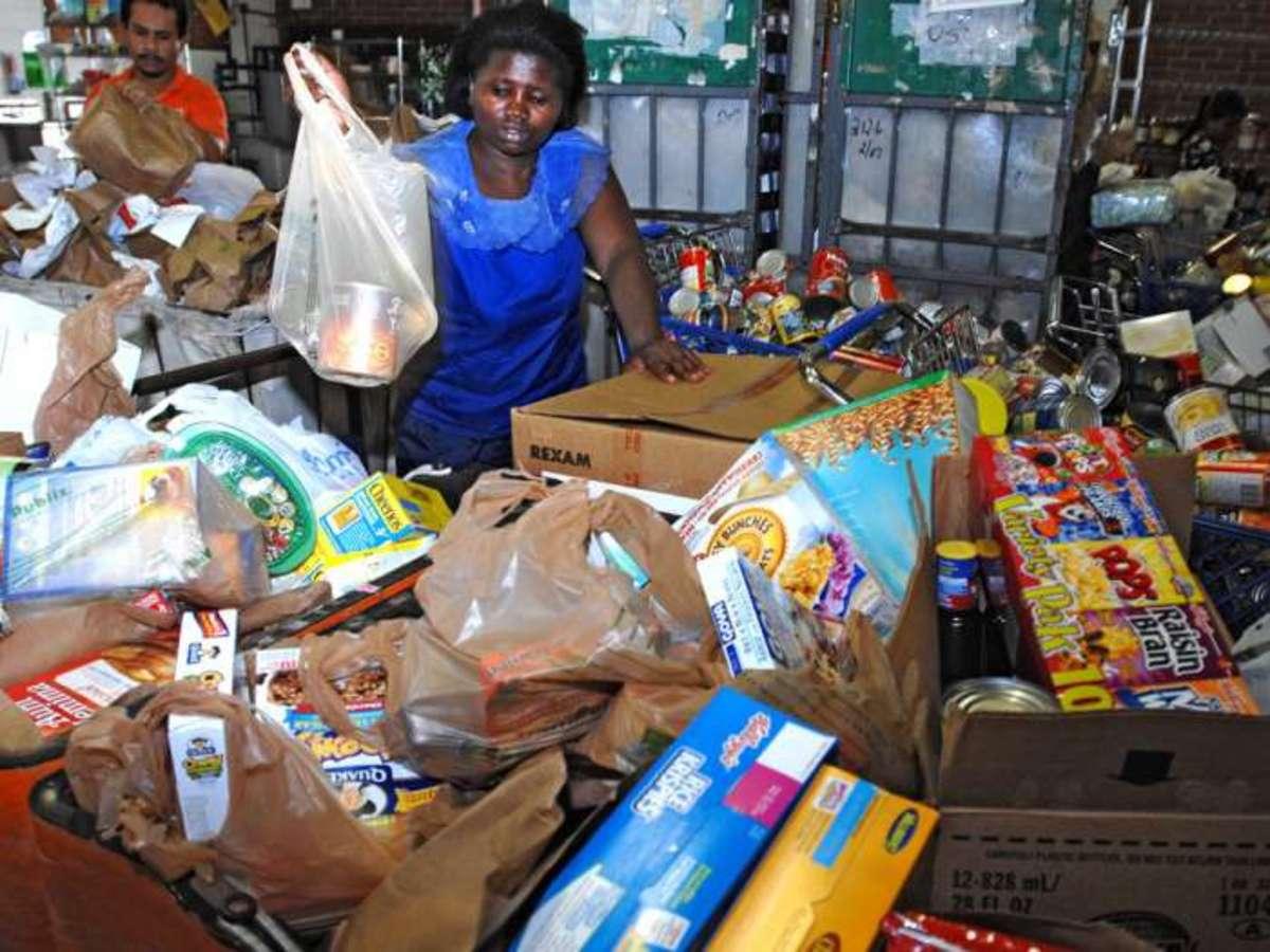 Donating plastic bags full of food to food banks.