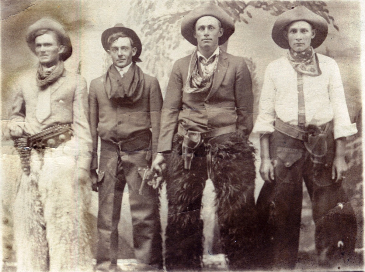 Originally posted to Flickr, this photo of four cowboys was allegedly taken between 1904 and 1918, according to the AZO postcard markings on the back.