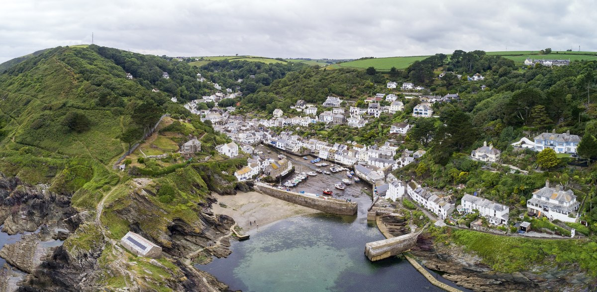 Polperro is known for its stunning fishing harbour, narrow streets, and high real estate prices.