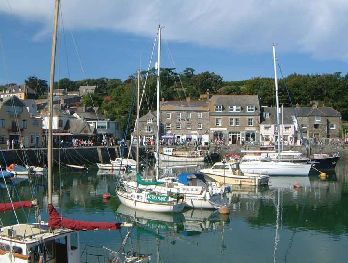 Padstow's harbour plays host to tourists and local fishermen alike.