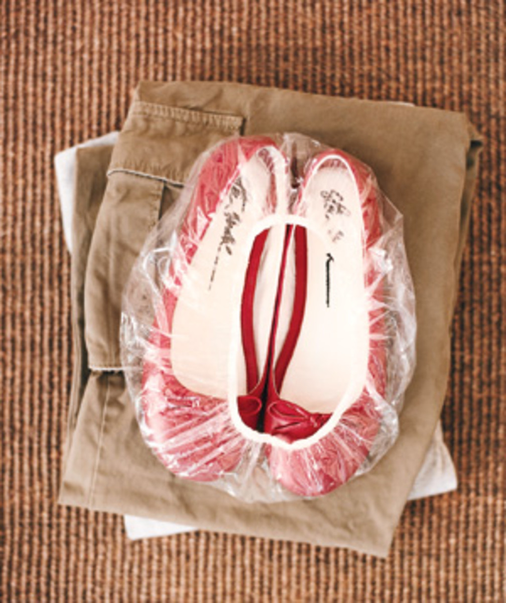 Keep your clothes clean in your suitcase by packing your shoes in a shower cap.