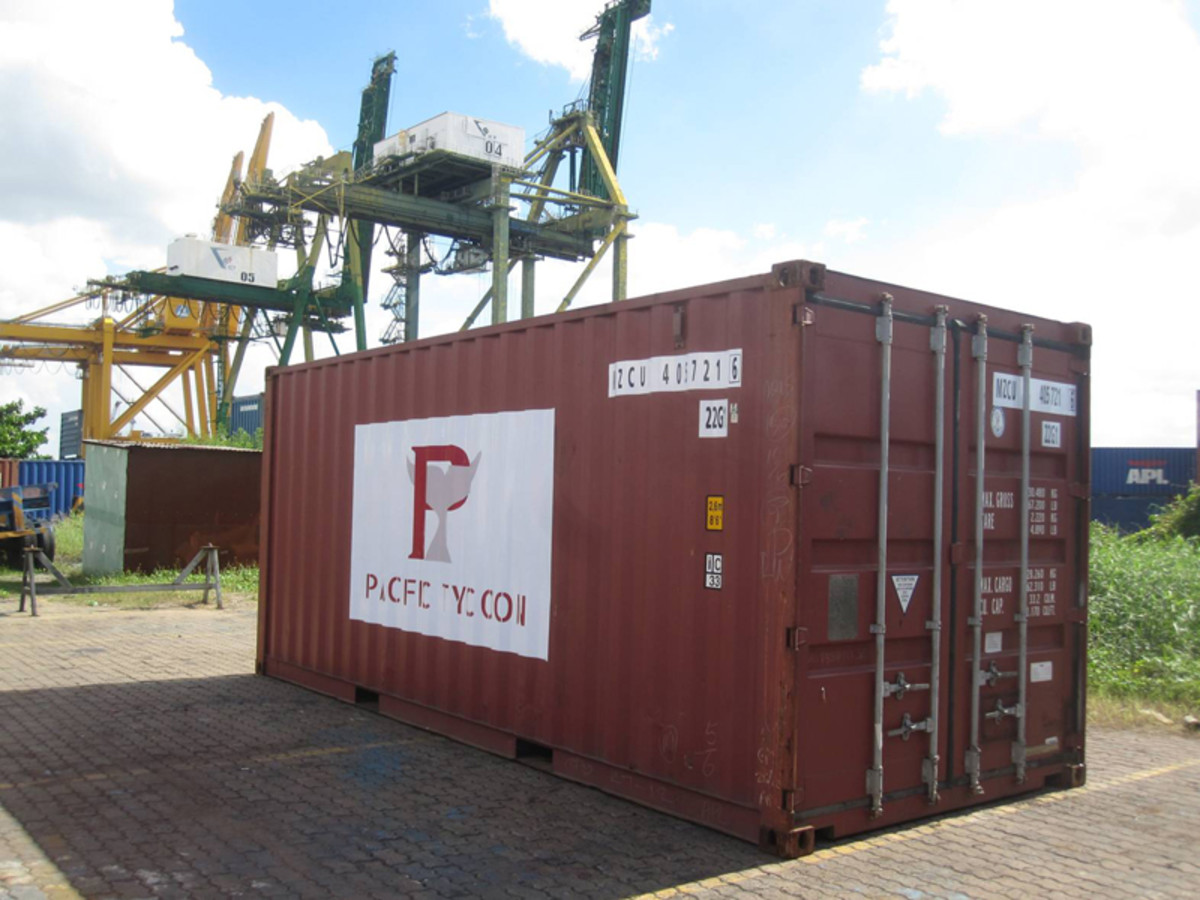 Recipe for success: Buy one shipping container. Put your latest, newest logo on it. Photograph a crap photo of it. Then post it on your website to convince everyone that everything is OK!