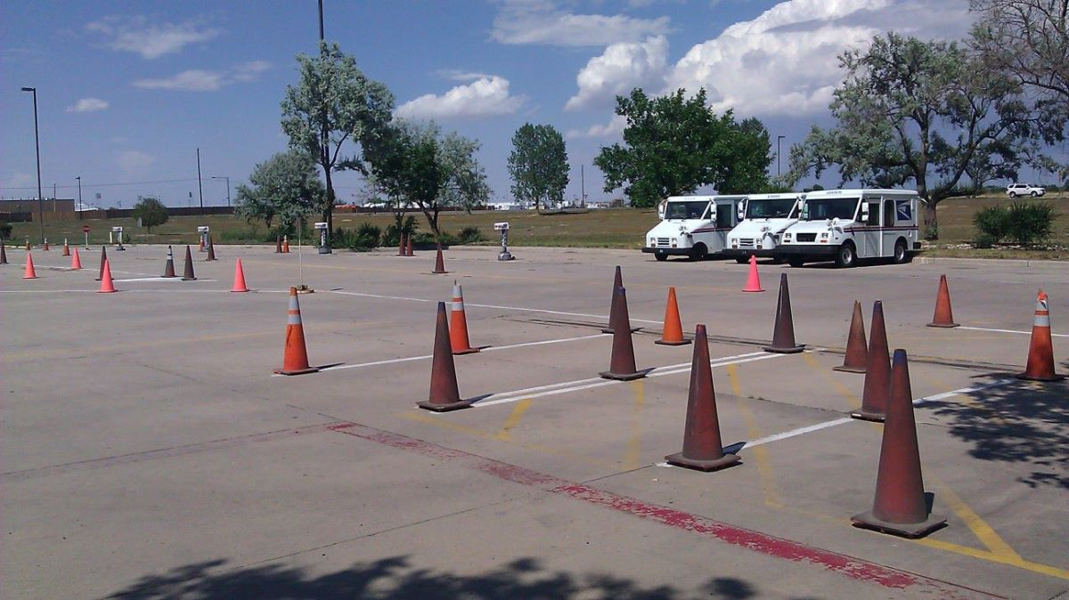 Your driving training facility will look something like this and yes, you will be expected to squeeze this enormous vehicle into these tiny parking spaces without injuring a cone.  LLVs are on the left, FFV on the right.